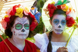 Mother and daughter dressed in costume at Day of the Dead (Dia de los Muertos) at Hollywood Forever Cemetery