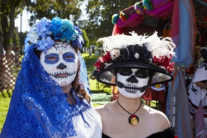 Women dressed in costume at Day of the Dead (Dia de los Muertos) at Hollywood Forever Cemetery