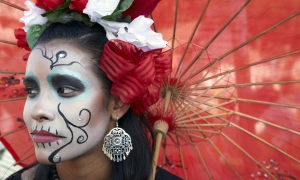 Woman wearing traditional outfits for Dios de Los Muertos, Day of the Dead, Hollywood Forever Cemetery