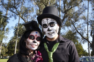 Couple dressed in costume at Day of the Dead (Dia de los Muertos) at Hollywood Forever Cemetery