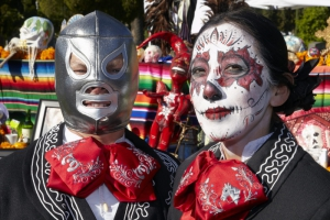 Man and woman dressed in costume at Day of the Dead (Dia de los Muertos) at Hollywood Forever Cemetery