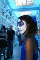Girl in costume stands in mausoleum at Day of the Dead (Dia de los Muertos) at Hollywood Forever cemetery