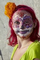 Portrait of girl with face painted at Day of the Dead (Dia de los Muertos) at Hollywood Forever cemetery